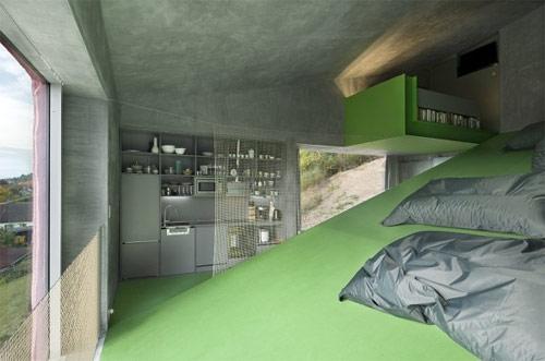 9420718 2768894e4d o Casa em declive de três andares acompanha a topografia